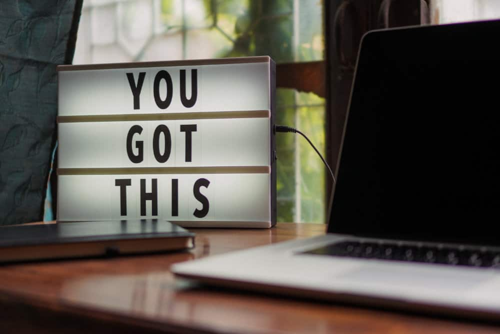 desk with motivational sign